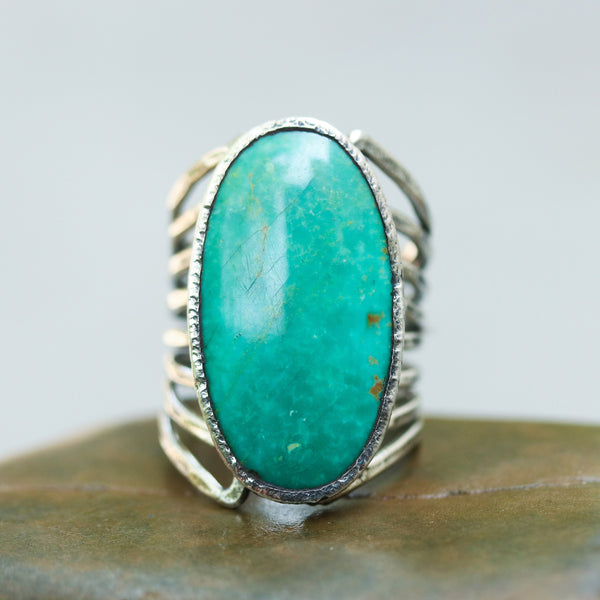 Turquoise ring in silver bezel setting with sterling silver skeleton multi wrap and hammer textured band