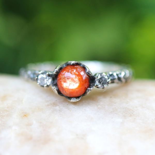Sunstone ring and tiny faceted diamond side set gems in prongs setting with sterling silver oxidized textured band - Metal Studio Jewelry