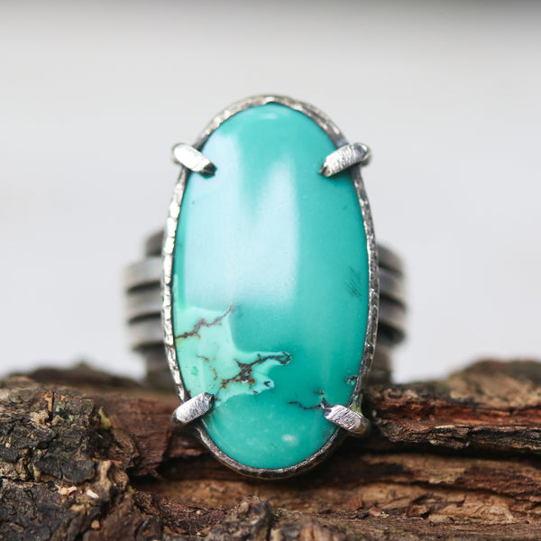 Oval cabochon Turquoise ring in silver bezel and prongs setting with sterling silver wrap thick band