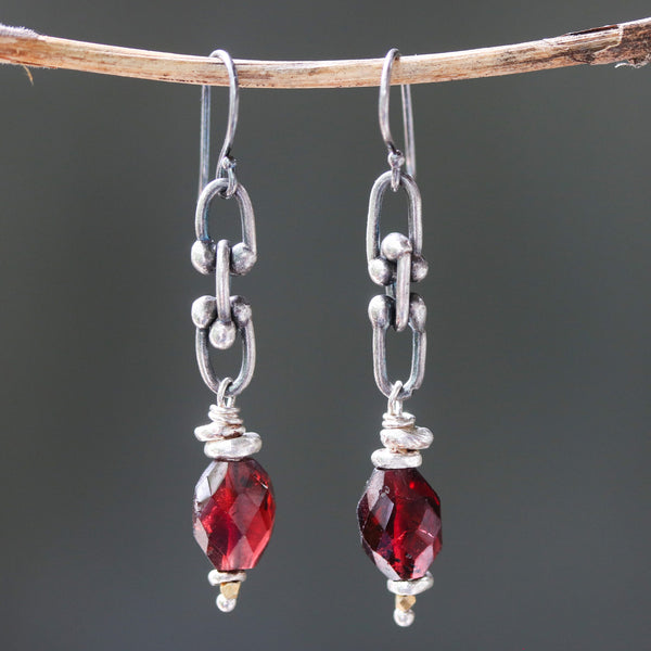Sterling silver oxidized cable chain eariings and decorated with red garnet on silver hooks style