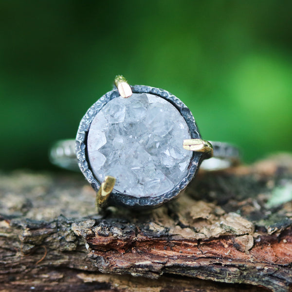 Grey round druzy quartz ring in silver bezel and brass prongs setting with sterling silver oxidized texture band