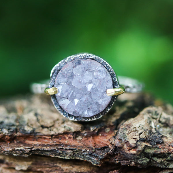 Grey/purple round druzy quartz ring in silver bezel and brass prongs setting with sterling silver oxidized texture band