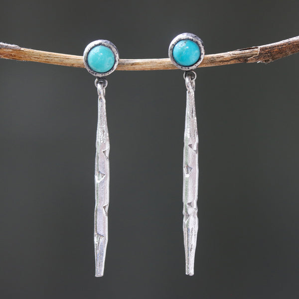 Silver spike earrings with round turquoise in silver bezel setting on sterling silver stud style