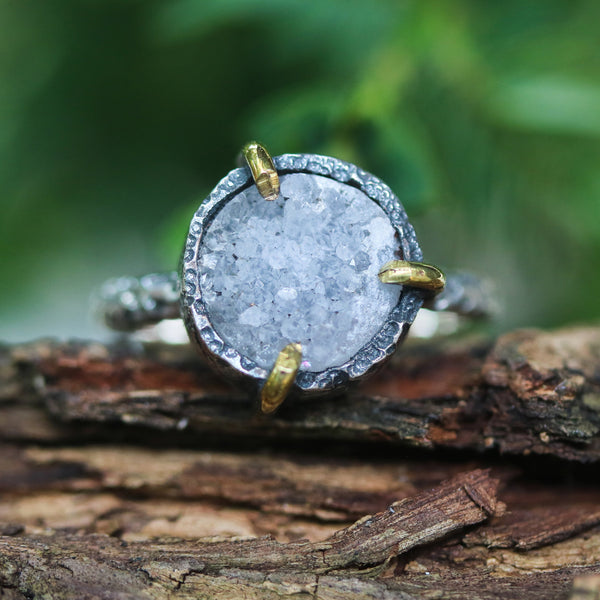 Grey round druzy quartz ring in silver bezel and brass prongs setting with sterling silver hard texture band