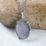 Sterling silver necklace with oval grey Druzy quartz pendant in silver bezel and prongs seeting