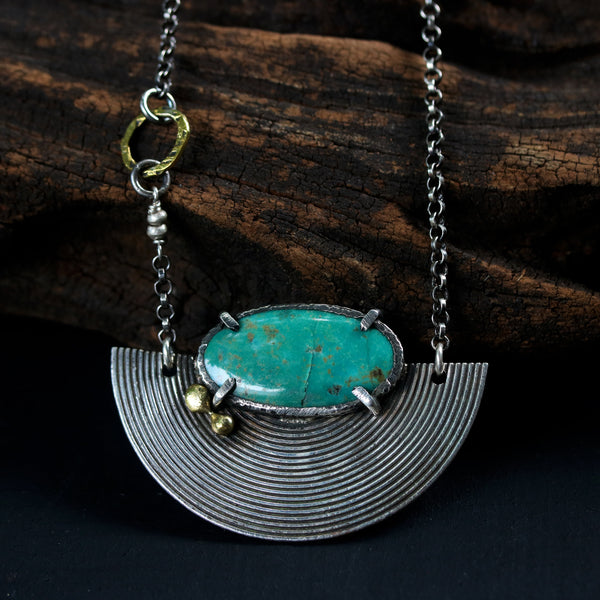 Green turquoise pendant necklace in silver bezel and prongs setting with silver fan and brass beads on sterling silver oxidized chain