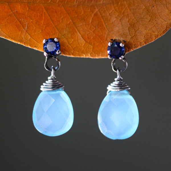 Dyed blue chalcedony teardrop faceted earrings with tiny blue sapphire on the top and sterling silver stud style - Metal Studio Jewelry
