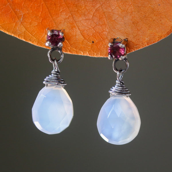 Dyed white chalcedony teardrop faceted earrings with tiny pink tourmaline on the top and sterling silver stud style - Metal Studio Jewelry