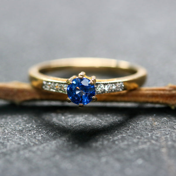 Wedding rings,round faceted Blue sapphire and diamonds with 22k gold band