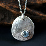 Round blue topaz with silver Lotus leaf pendant necklace on oxidized sterling silver chain - Metal Studio Jewelry