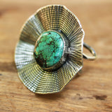Flower pendant with turquoise ring in silver bezel setting and with sterling silver wrap band - Metal Studio Jewelry