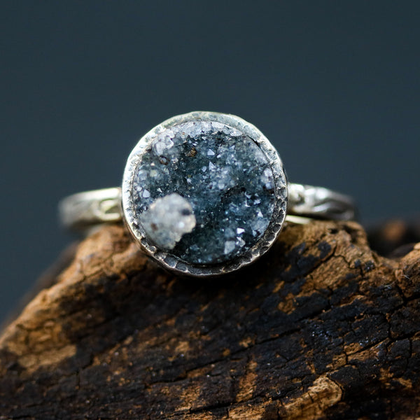 Black round druzy quartz ring in silver bezel setting with sterling silver leaf design band