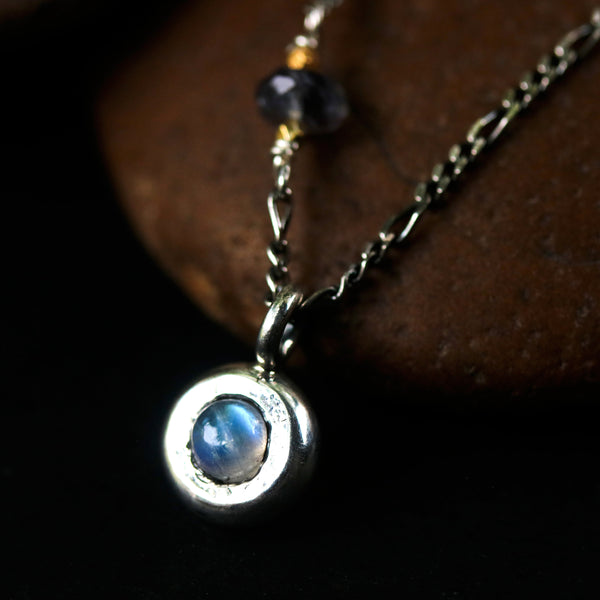 Tiny round cabochon Moonstone pendant necklace with iolite beads on the side - Metal Studio Jewelry