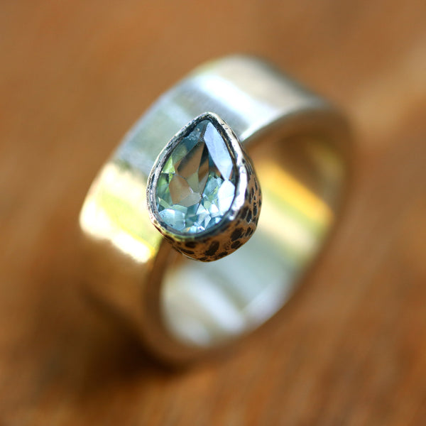Teardrop faceted Swiss blue topaz ring in silver bezel setting on sterling silver high polished band - Metal Studio Jewelry
