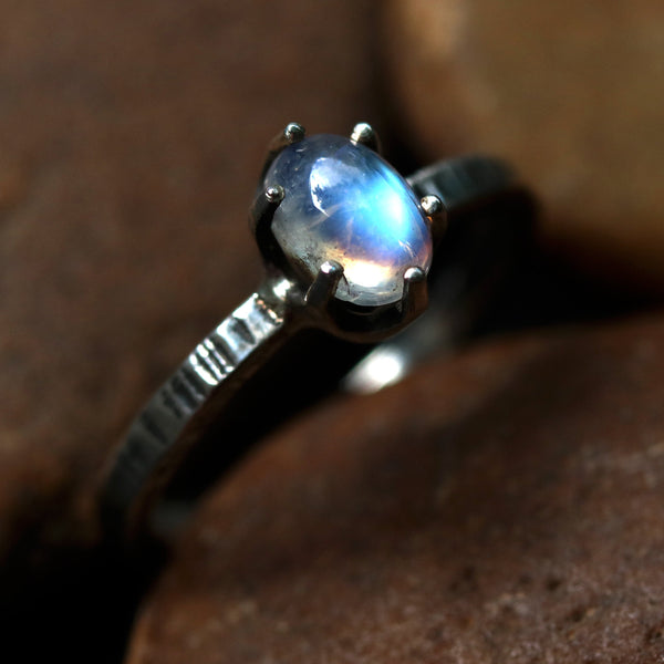 Moonstone ring in silver prongs setting with sterling silver oxidized texture band