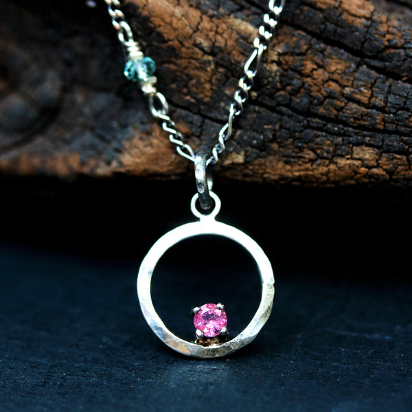 Sterling silver circle necklace decorated with tiny pink sapphire on silver oxidized chain