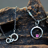 Sterling silver circle necklace decorated with tiny pink sapphire on silver oxidized chain - Metal Studio Jewelry