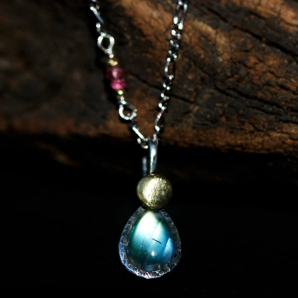 Moonstone pendant necklace in sterling silver bezel setting with pink multi sapphire beads on the side