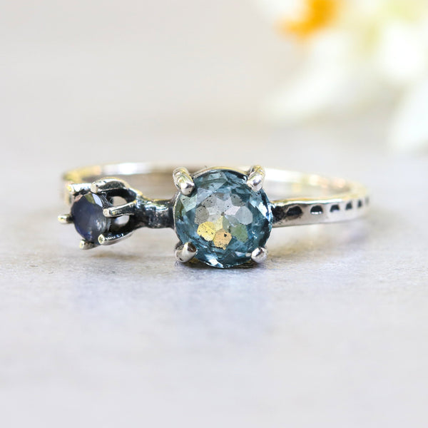 Round blue topaz ring in silver bezel and prongs setting with round moonstone - Metal Studio Jewelry