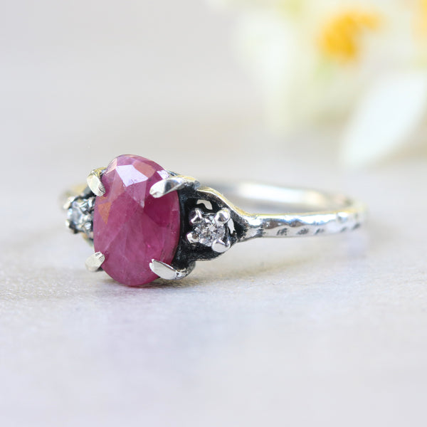 Red ruby ring with tiny diamond side set in silver prongs setting - Metal Studio Jewelry