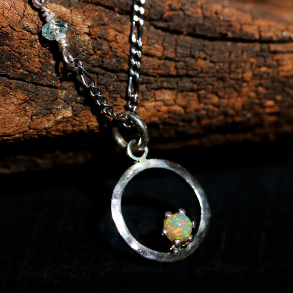 Sterling silver circle necklace decorated with tiny opal on silver oxidized chain