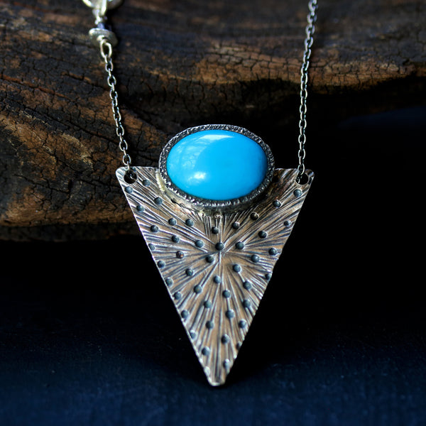 Oval blue turquoise pendant necklace in silver bezel setting with engraving technique in silver triangle shape - Metal Studio Jewelry