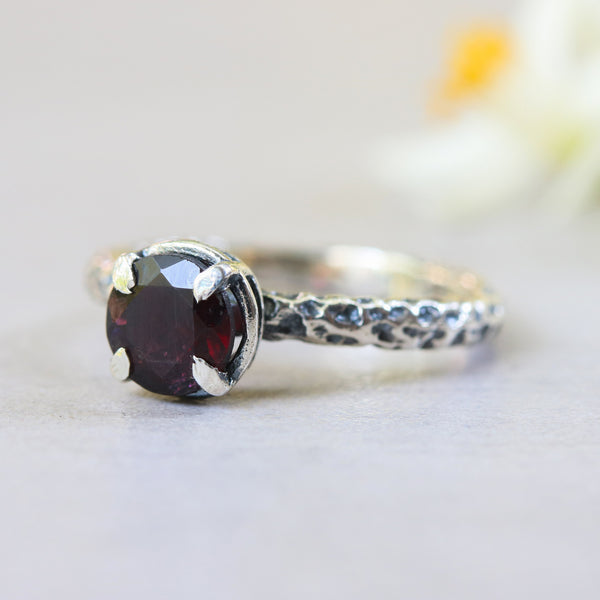 Tiny round faceted garnet ring in silver bezel and 4 prongs setting with sterling silver oxidized texture band