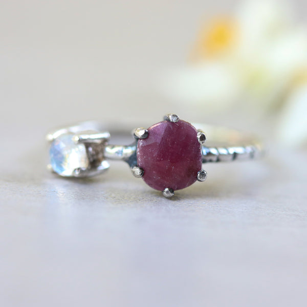 Faceted ruby ring in silver prongs setting and faceted moonstone with sterling silver texture band