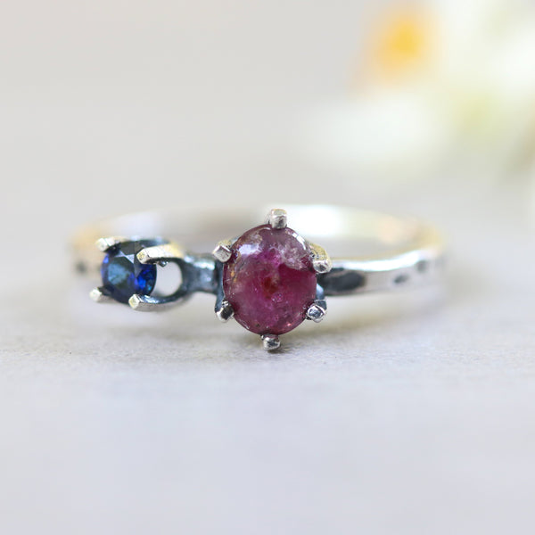 Cabochon red ruby ring in silver prongs setting and tiny blue sapphire