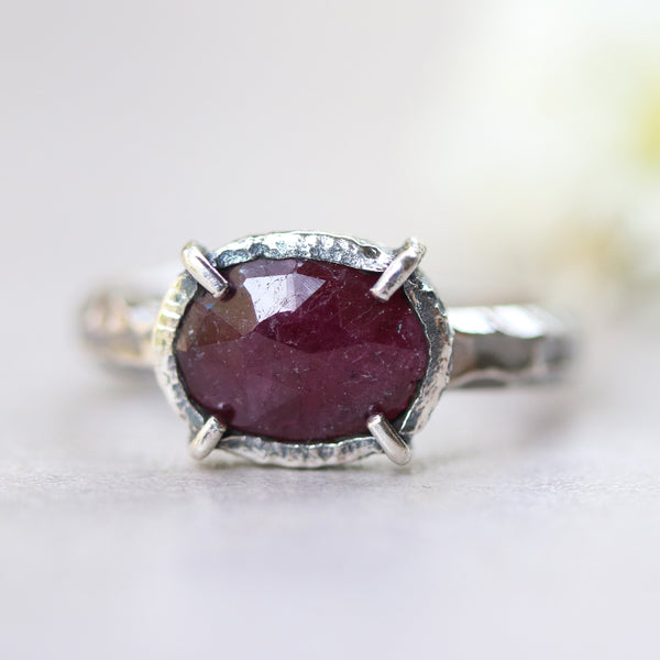 Oval faceted ruby ring in silver bezel and prongs setting with sterling silver oxidized hard textured band - Metal Studio Jewelry