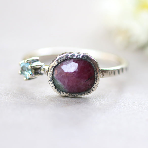 Ruby zoisite ring in bezel setting with round blue topaz on  sterling silver oxidized texture band - Metal Studio Jewelry