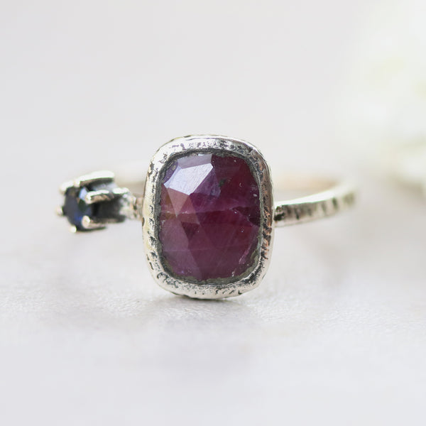 Rectangle red Ruby ring in bezel setting with round blue sapphire on sterling silver oxidized texture band - Metal Studio Jewelry