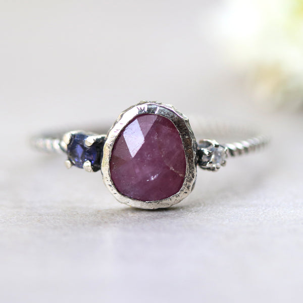 Pink ruby ring in silver bezel setting with tiny round faceted moonstone and iolite side set gems on sterling silver twist band - Metal Studio Jewelry