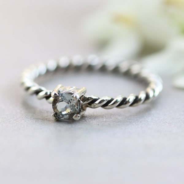 Tiny round faceted blue topaz ring in prongs setting with sterling silver oxidized twist design band - Metal Studio Jewelry