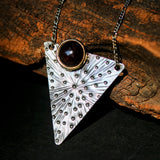 Round garnet pendant necklace in brass bezel setting with engraving technique in silver triangle shape - Metal Studio Jewelry