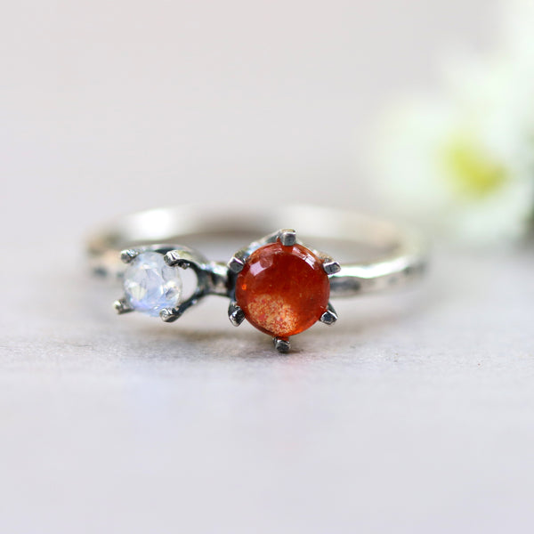 Cabochon Sunstone ring in silver prongs setting and moonstone on the side - Metal Studio Jewelry