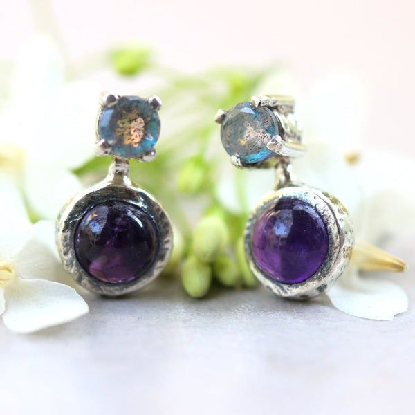 Amethyst round cabochon earrings with tiny labradorite on the top in silver bezel and prongs setting with sterling silver stud style - Metal Studio Jewelry