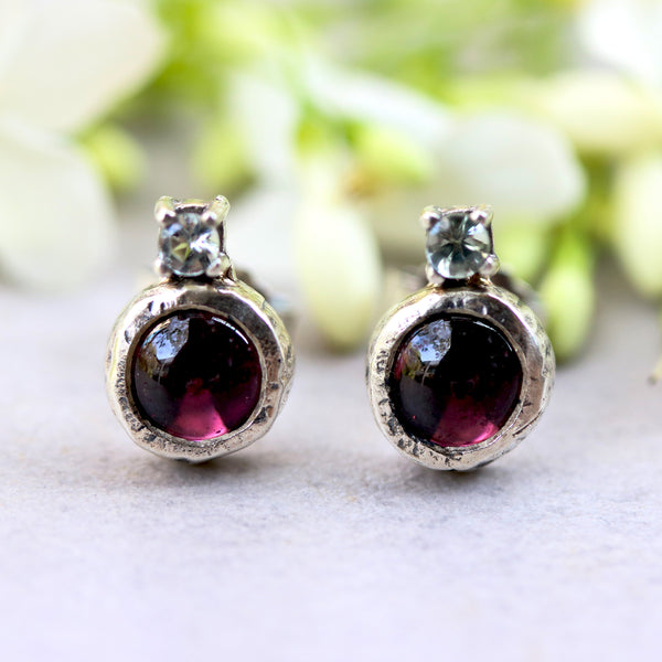 Round garnet stud earrings and blue topaz on the top in silver bezel and prongs setting with sterling silver post and backing - Metal Studio Jewelry