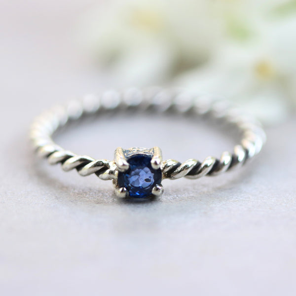 Tiny round faceted blue sapphire ring in prongs setting with sterling silver oxidized twist design band - Metal Studio Jewelry