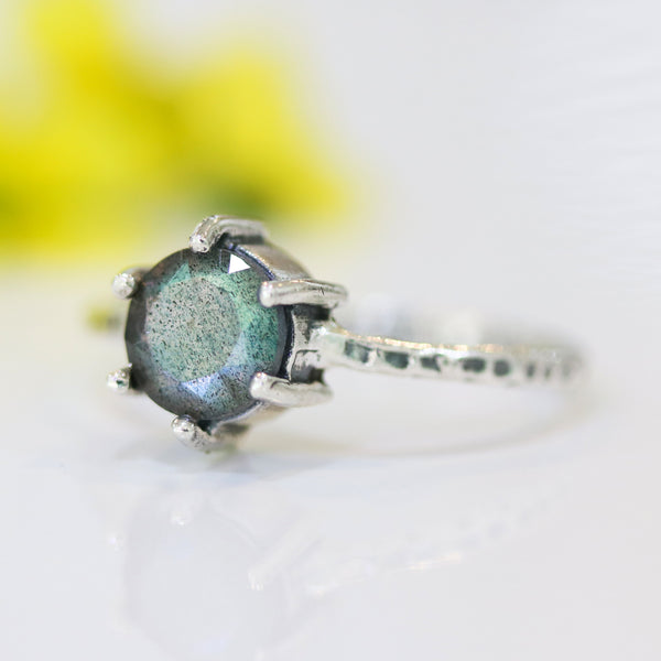 Round faceted labradorite ring in 6 prongs setting with sterling silver oxidized texture band