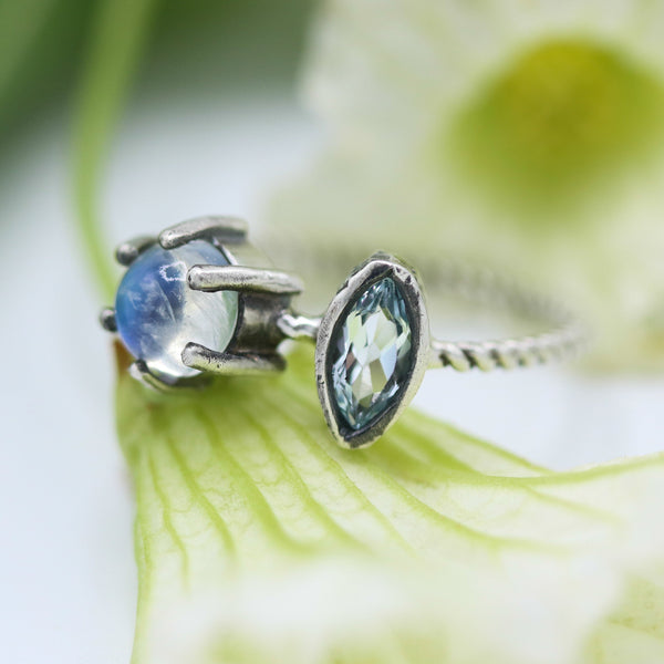 Marquis faceted Swiss blue topaz ring in silver bezel setting and moonstone on the side with sterling silver twist design band - Metal Studio Jewelry