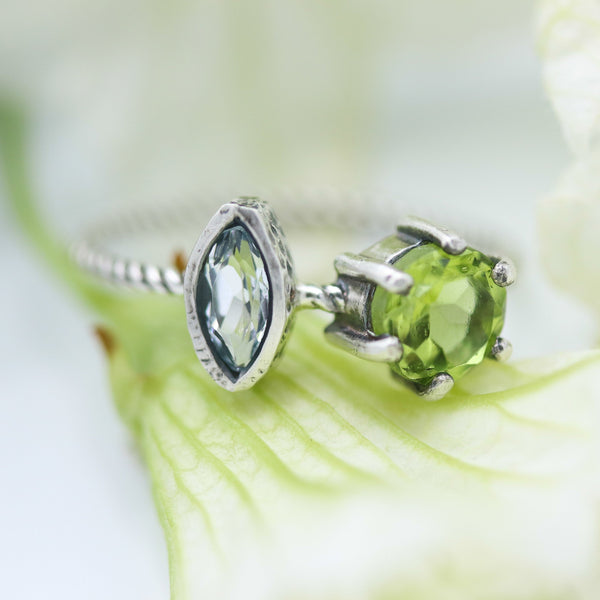 Marquis faceted blue topaz ring in silver bezel setting and round peridot on the side with sterling silver twist design band - Metal Studio Jewelry