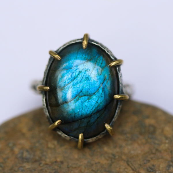 Oval Labradorite ring in silver bezel and brass prongs  setting with sterling silver hard texture oxidized band - Metal Studio Jewelry