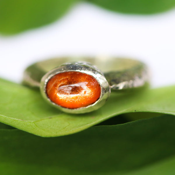Oval cabochon Sunstone ring in silver bezel setting with sterling silver oxidized texture thick band - Metal Studio Jewelry