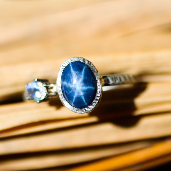 Oval blue star sapphire ring and tiny oval moonstone in silver bezel setting with sterling silver texture band - Metal Studio Jewelry