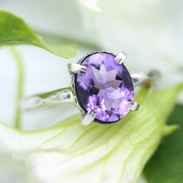 Oval faceted Amethyst ring in silver bezel and prongs setting in silver texture oxidized band - Metal Studio Jewelry