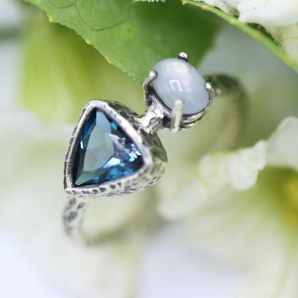 Triangle London blue topaz ring in silver bezel setting and moonstone on the side with sterling silver texture band - Metal Studio Jewelry