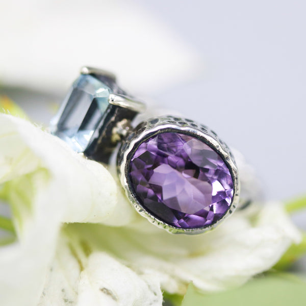 Oval faceted Amethyst ring and baguette cut blue topaz on the side with sterling silver twist design band - Metal Studio Jewelry