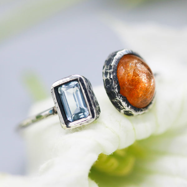 Oval cabochon Sunstone ring and blue topaz in silver bezel setting on sterling silver texture band - Metal Studio Jewelry