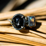 Black star diopside cabochon ring in silver bezel and brass prongs setting with rectangle moonstone on the side - Metal Studio Jewelry